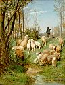 Shepherd with flock at a riverbank